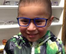 Bright blue frames on this sweet little man.